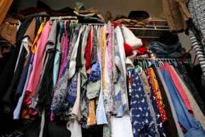 Messy Women's Closet Filled With Colorful Clothes