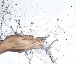 woman hand in water splash