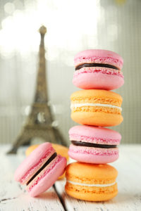 French Colorful Macarons On White Wooden Background