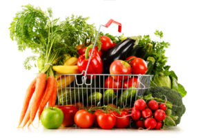 Organic Vegetables And Fruits In Shopping Basket On White